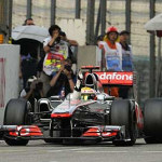 Button Wins, Vettel Clinches